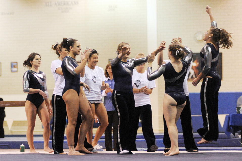 Women gymnasts compete in tri-meet