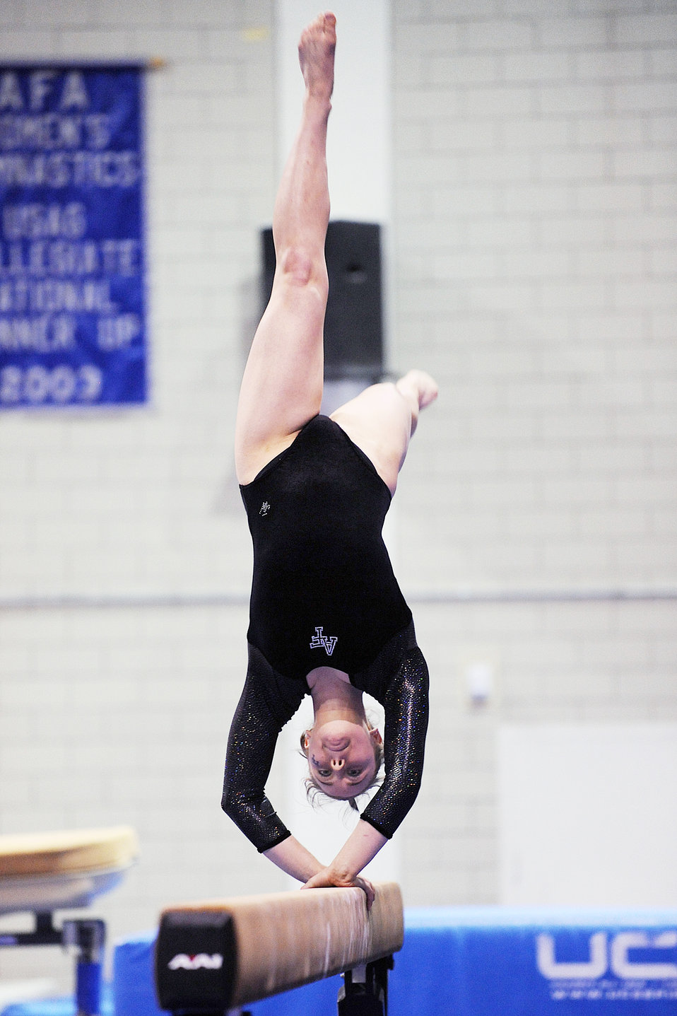 A gymnast on a balance beam