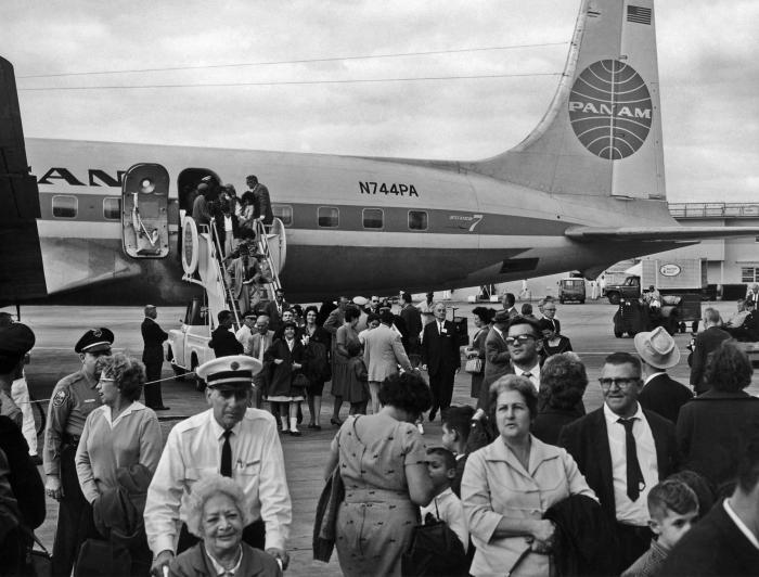 This photograph shows numerous Cuban citizens arriving in Miami, Florida after being airlifted from Cuba in 1965. The U.S. Public Health Ser
