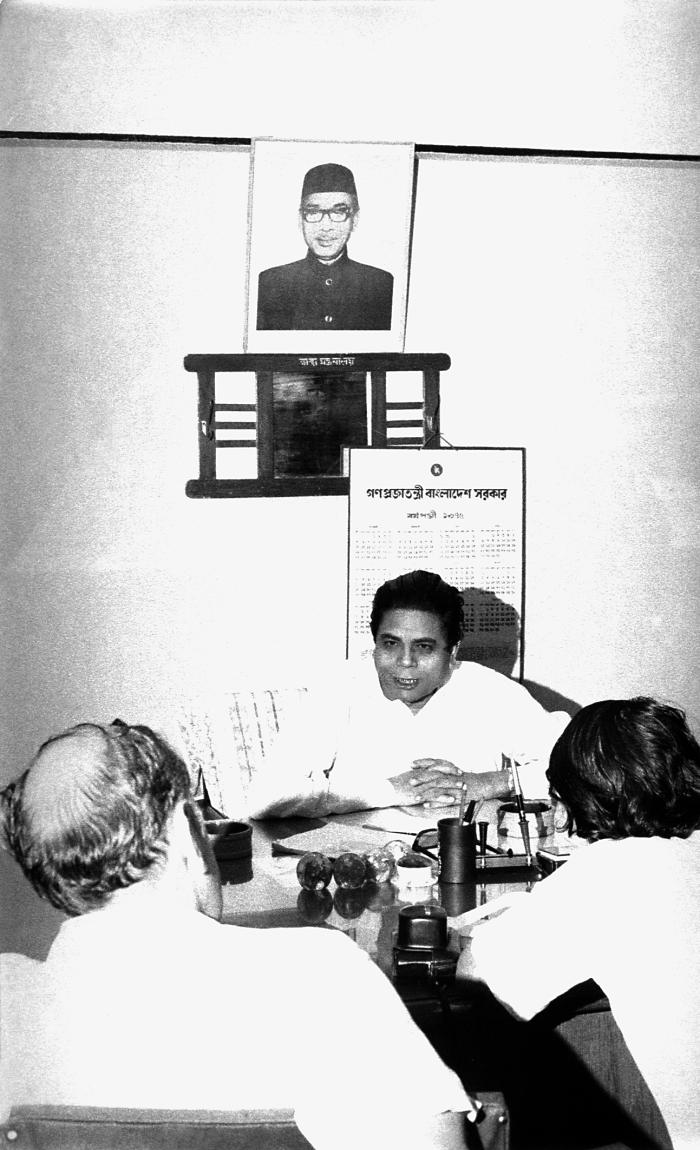 Though his name is unknown, this 1975 photograph depicted one of the Bangladesh Secretaries of Health, as he was seated behind his desk duri