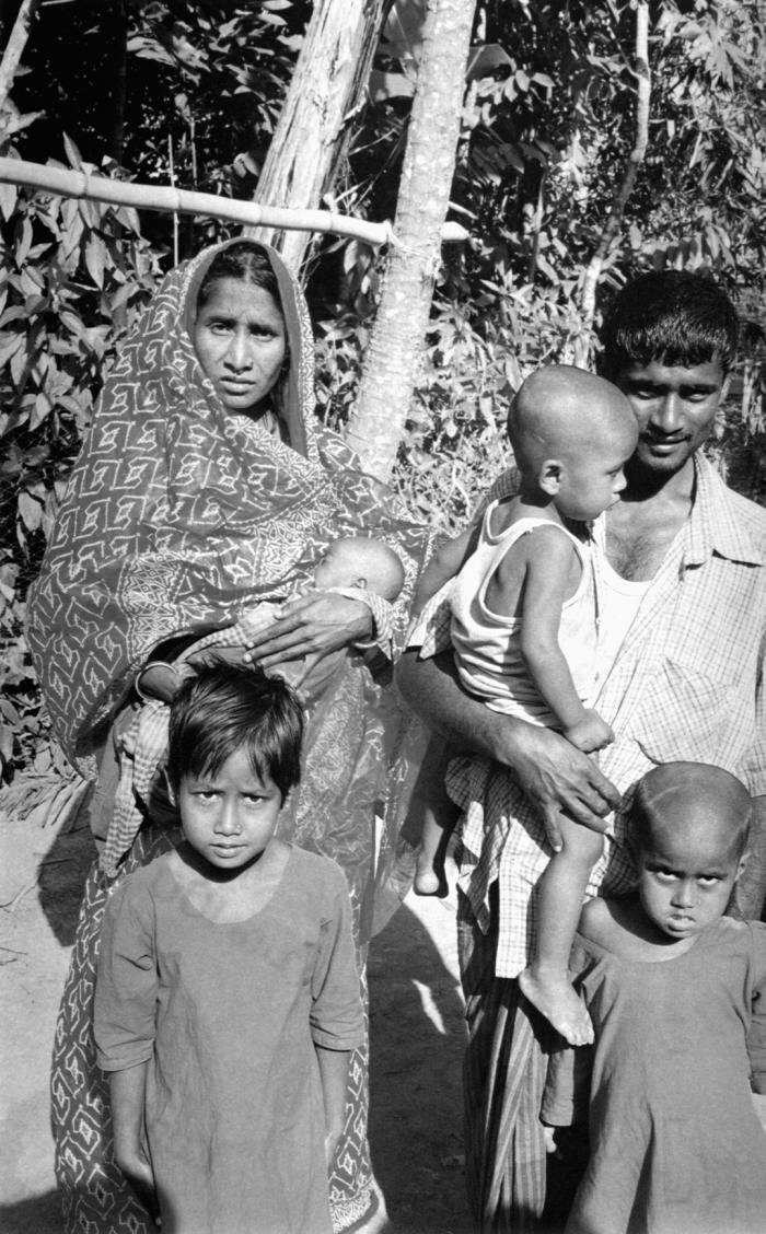 This photograph was captured in 2000, and what makes it so intriguing, is that the Bangladesh woman holding her child is Rahima Banu, who 25