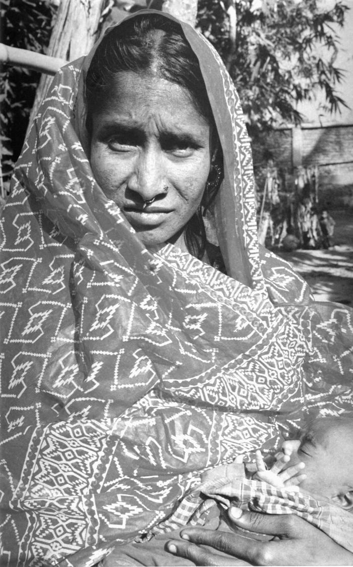 This photograph was captured in 2000, and what makes it so intriguing is that the Bangladesh woman holding her child is Rahima Banu, who 25