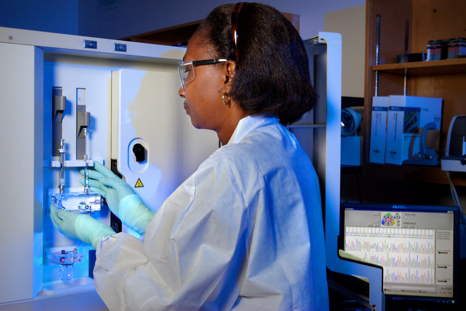 This 2007 photograph depicts CDC Guest Researcher, Dr. Karidia Diallo, preparing the ABI DNA Analyzer for drug resistance  testing upon samp