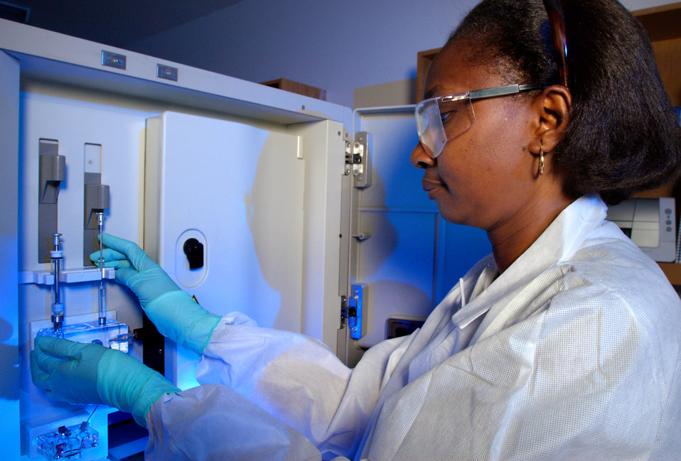 This 2007 photograph depicts CDC Guest Researcher, Dr. Karidia Diallo, preparing the ABI DNA Analyzer for drug resistance testing upon sampl
