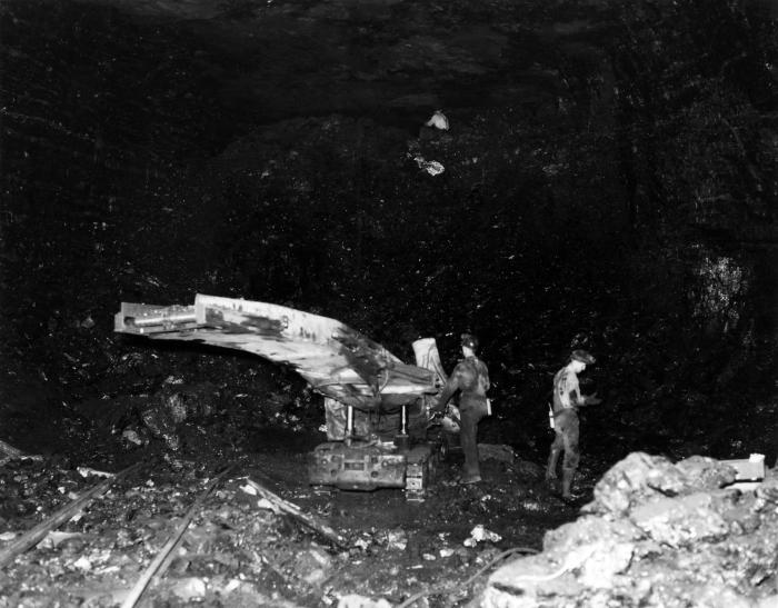 This historic image, from the 1950s to 1960s, depicted two miners in the subterranean confines of a submanrine St. Jonn, Canadian iron ore m