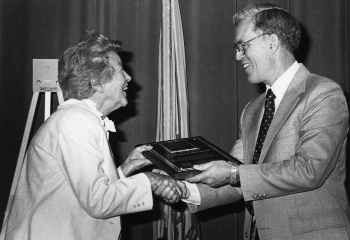 This 1986 photograph depicted the Centers for Disease Control Director at that time, Dr. James O. Mason (right), presenting a plaque to the