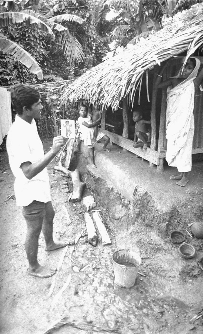 During his house to house search for possible smallpox cases, this Bangladesh smallpox eradication team volunteer was photographed while he