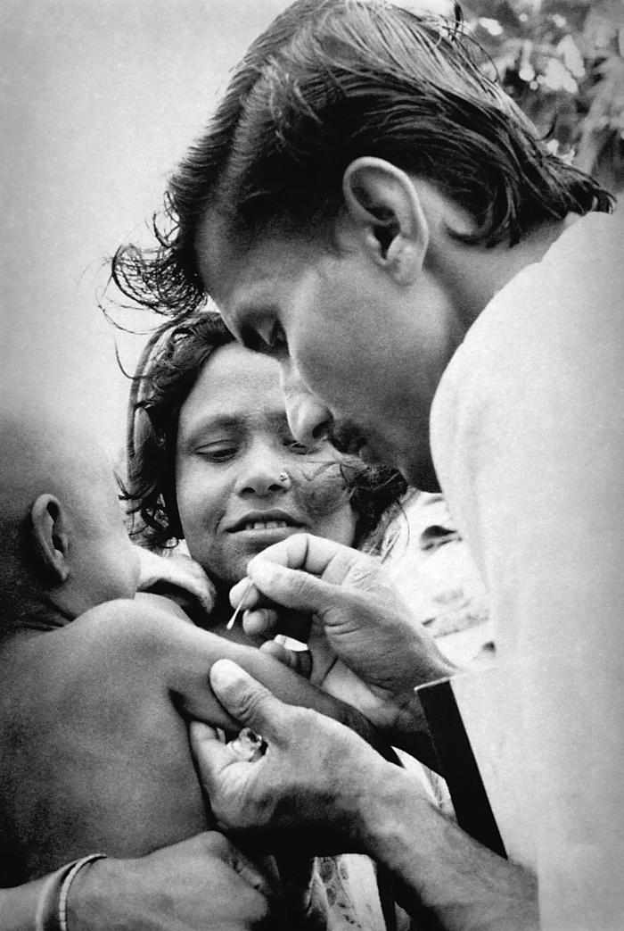 This Bangladesh volunteer smallpox eradication team vaccinator was in the process of administering a vaccination to the right upper arm of a