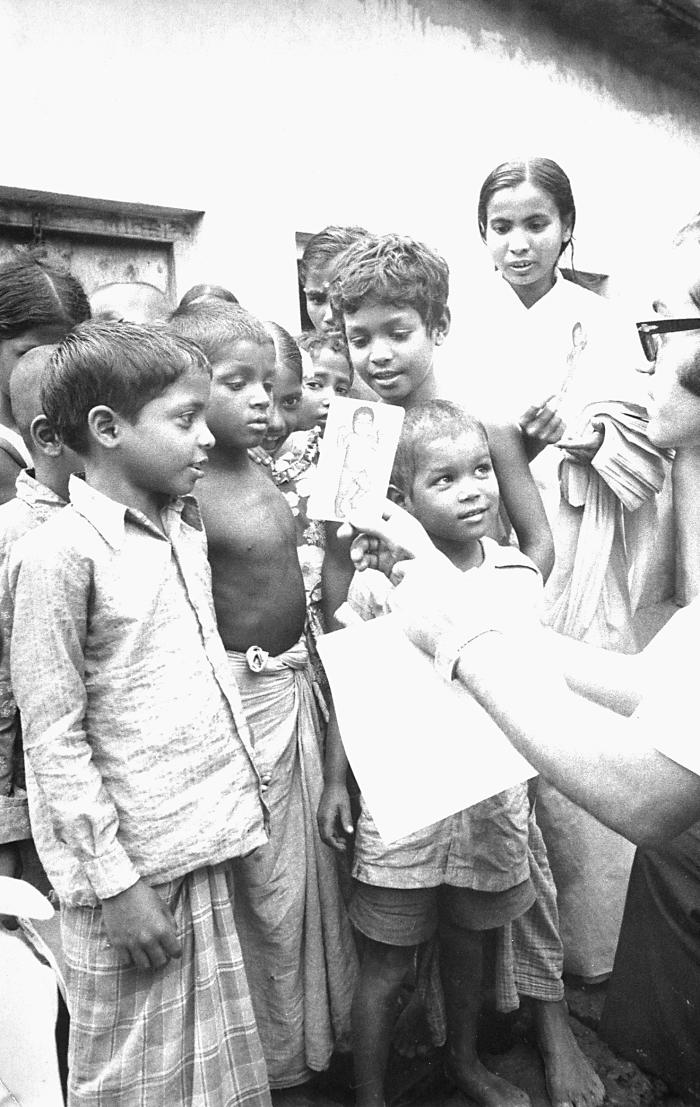 This photograph depicted World Health Organization (WHO) epidemiologist Dr. Ali Mourad, as he was showing a group of Bangladesh village chil