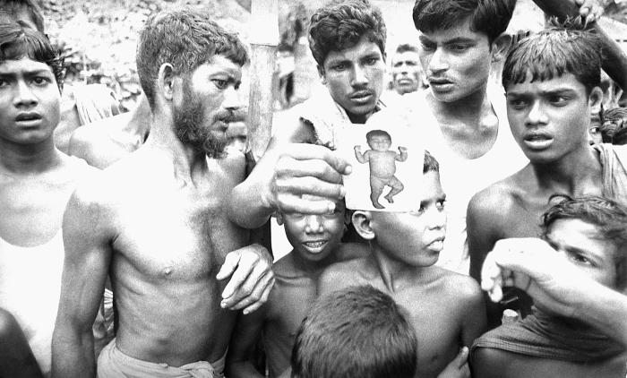 This 1975 photograph captured these Bangladesh village residents as they were examining the standard smallpox-case photograph. On one side w