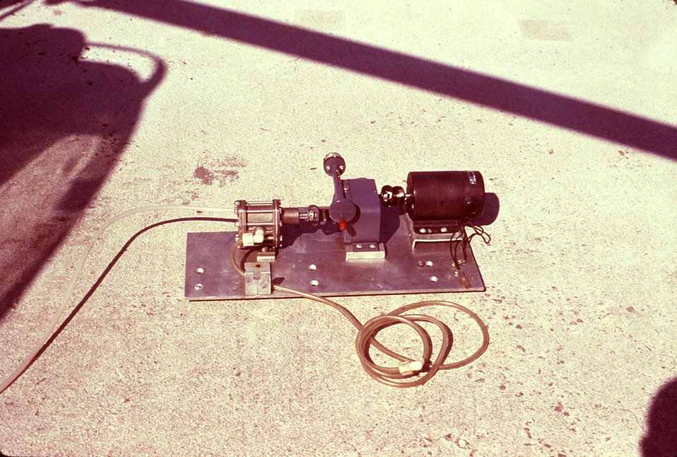 This photograph depicts the spray drive unit, which powered an insecticidal fog generator's dispersal mechanism attached to a Hughes helicop