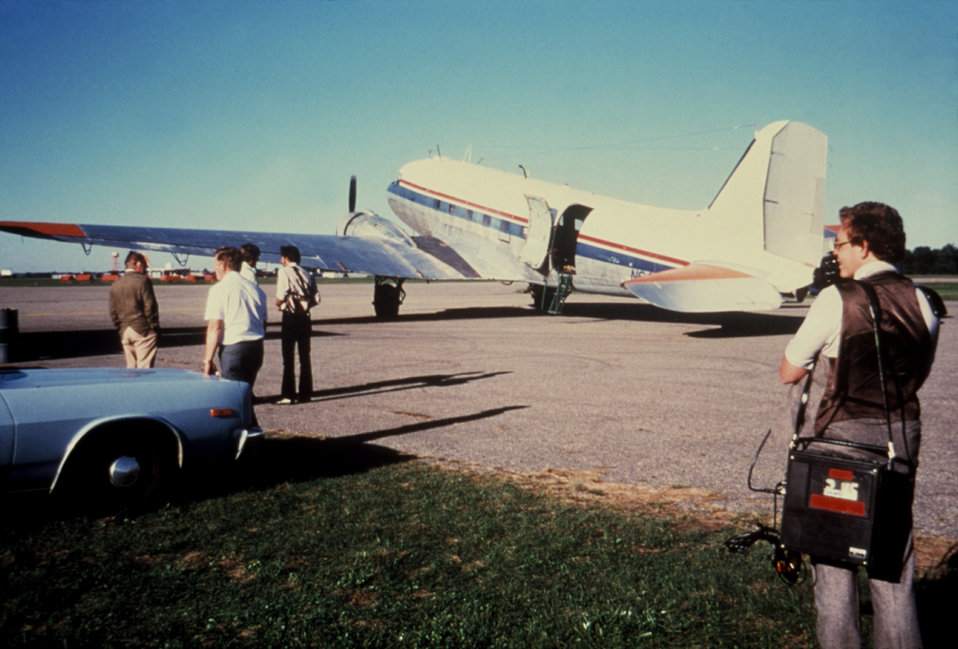 This 1980 photograph depicts a DC-3 aircraft used in the dispersal of ultra-low volume (ULV) Malathion insecticidal fog in order to control