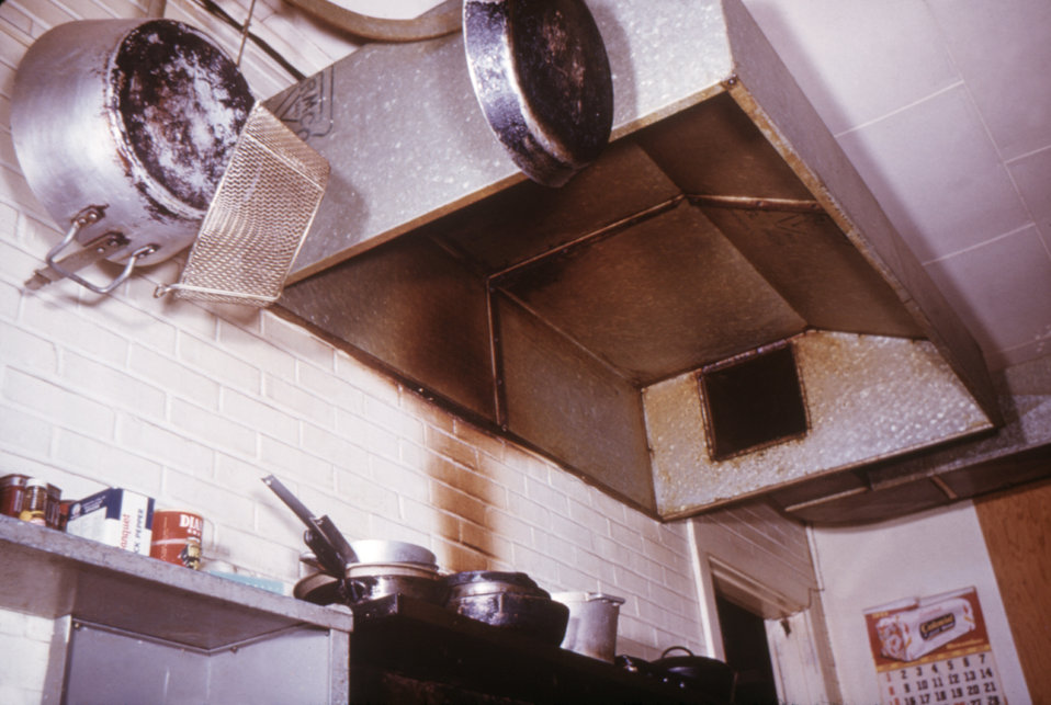 This poorly maintained kitchen range hood was found to be greasy, which could have predisposed it to cause a fire.