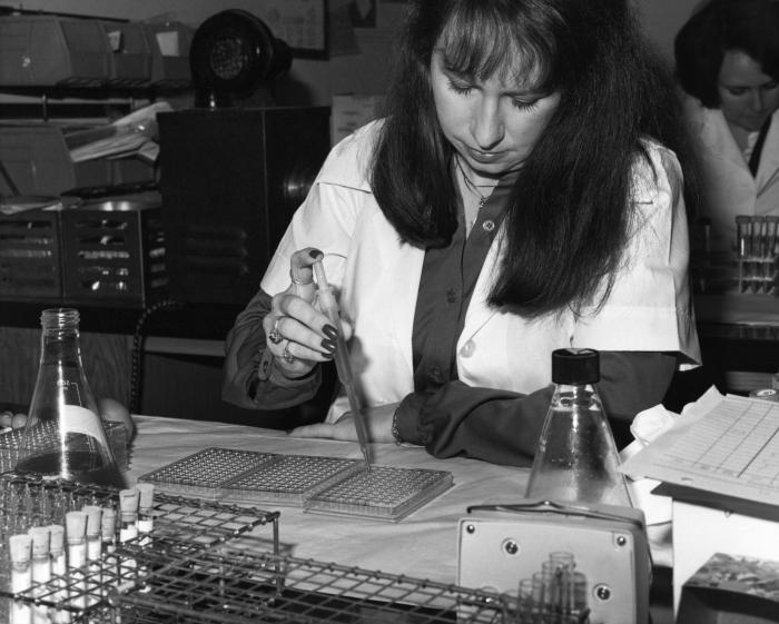 This Centers for Disease Control microbiologist was shown here delivering tissue culture specimens into a microtiter plate using an instrume