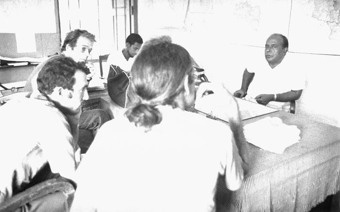 This 1975 image depicted a number of eradication campaign officials who were meeting to discuss strategies, and update one another as to pro