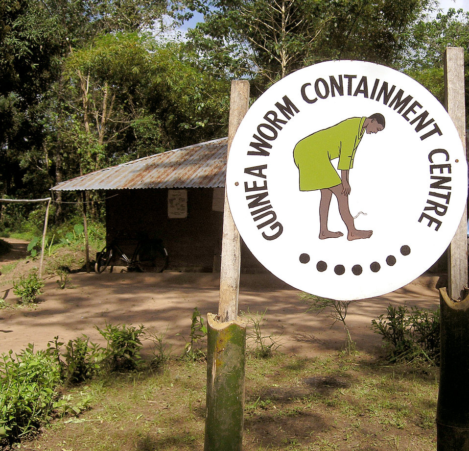 This 2004 photograph depicted the entrance to a Nigerian Guinea worm containment center. The sign at the entrance displayed a drawing of a G