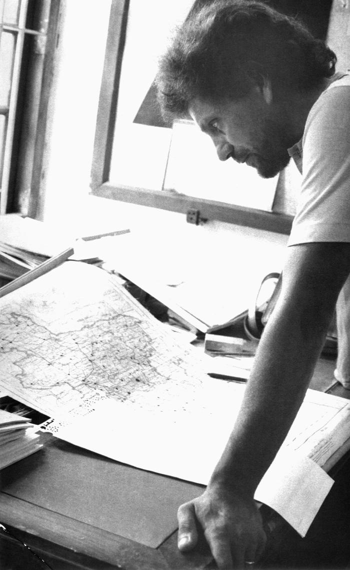 This 1975 image depicted Dr. Daniel Tarantola, a World Health Organization epidemiologist, as he was analyzing Bangladesh district maps, whi