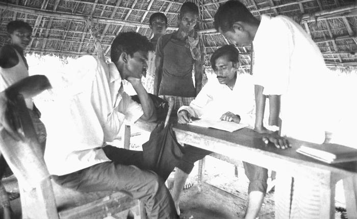 These local Bangladesh men were analyzing collected data under a field hut location. The keeping of detailed records was extremely important