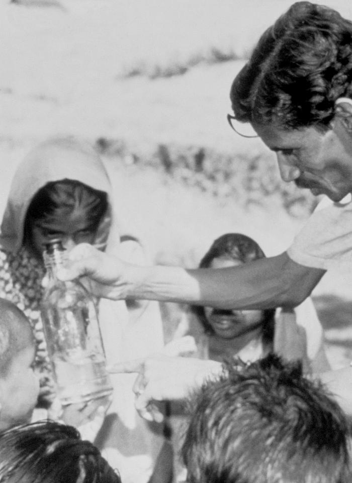 This 1990 photograph depicted a field technician holding an unfiltered bottle of water that had been extracted from a nearby stream. A numbe