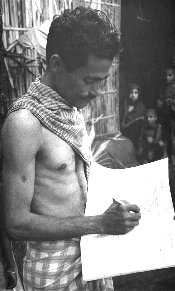 This 1975 image depicted a local Bangladesh man who was working as a smallpox eradication campaign volunteer, and showed the man entering da