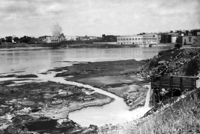 This historic 1937 photograph showed a paper plant's sewer outlet as it was emptying its contents into the Rainy River, seen from the Intern