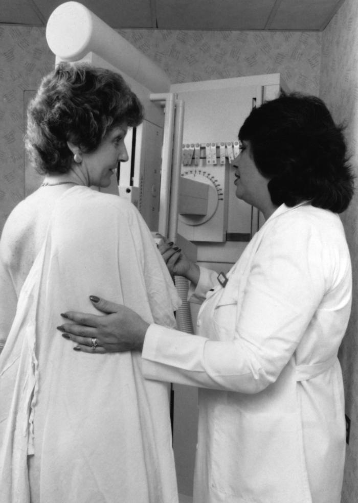 This photograph depicting one of the steps performed in receiving a mammogram was taken for use in a previous public health awareness campai