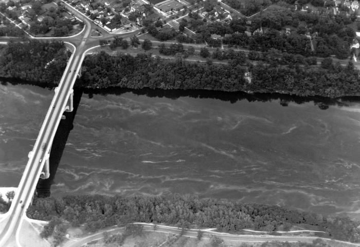 In this historic aerial view of the Mississippi River, the Franklin Avenue Bridge is seen at left just outside Minneapolis, Minnesota taken