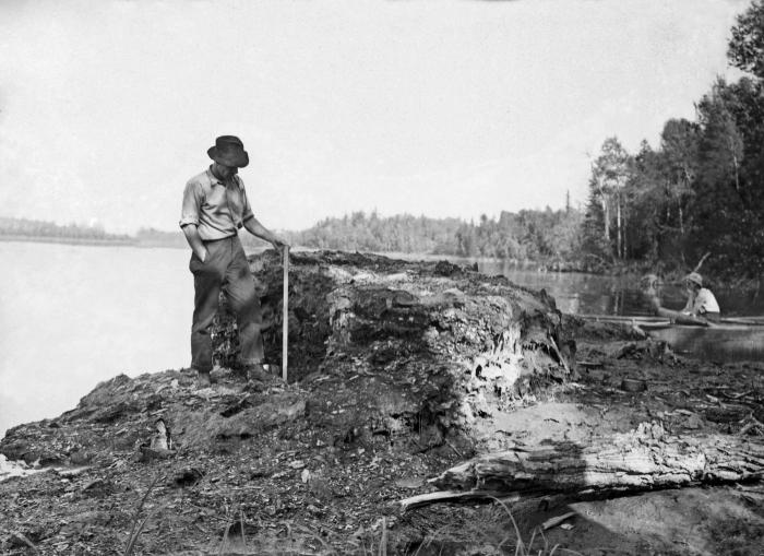 This historic 1937 photograph showed a mass of wood fibers, and mill waste lodged on a river bank a short distance downstream from an Intern