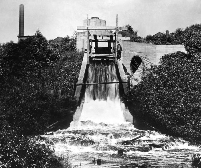 This historic image depicted a large weir that had been installed at a Morgan Park, Minnesota waterway near Duluth, in order to measure wast