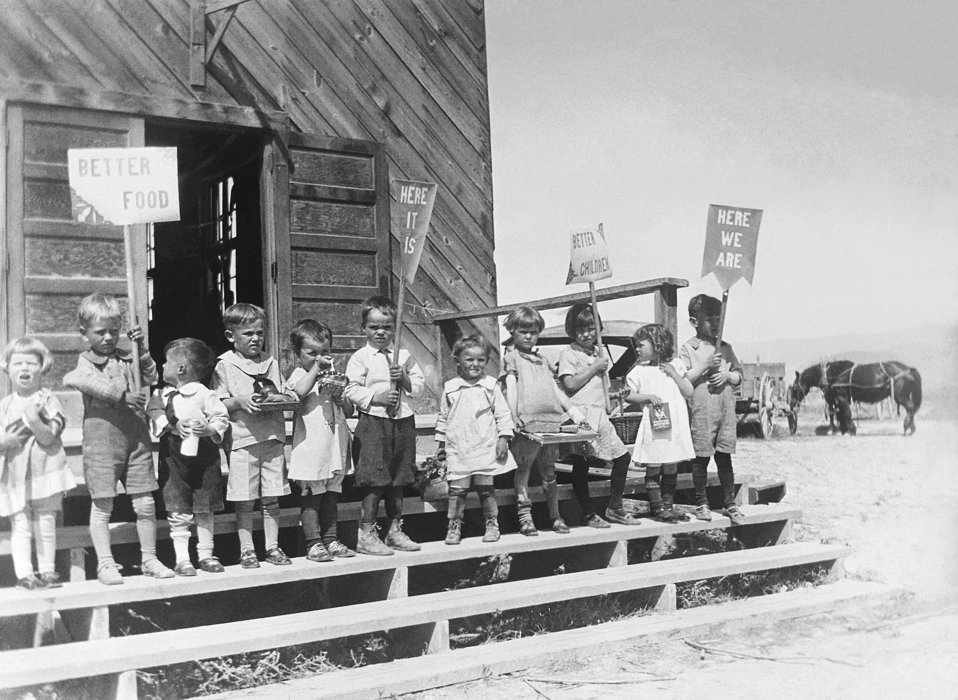 This historic photograph showed a group of children who had gathered in an observance of 'Child Health Day', displaying signs with attention