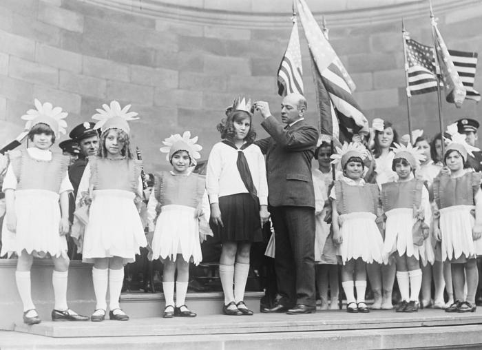 This historic photograph depicted an gathering of school children assembled on a stage during a presentation marking the observance of 'Chil