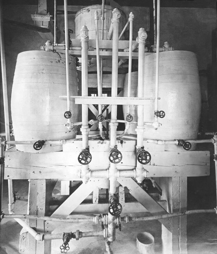 In this historic 1912 photograph, some of the interior machinery was revealed inside a hypochlorite plant in Stillwater, Minnesota. This dev
