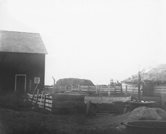 This 1909 photograph depicted an improperly constructed 'dug' well situated on the grounds of a Minnesota farm home. It was one of a series