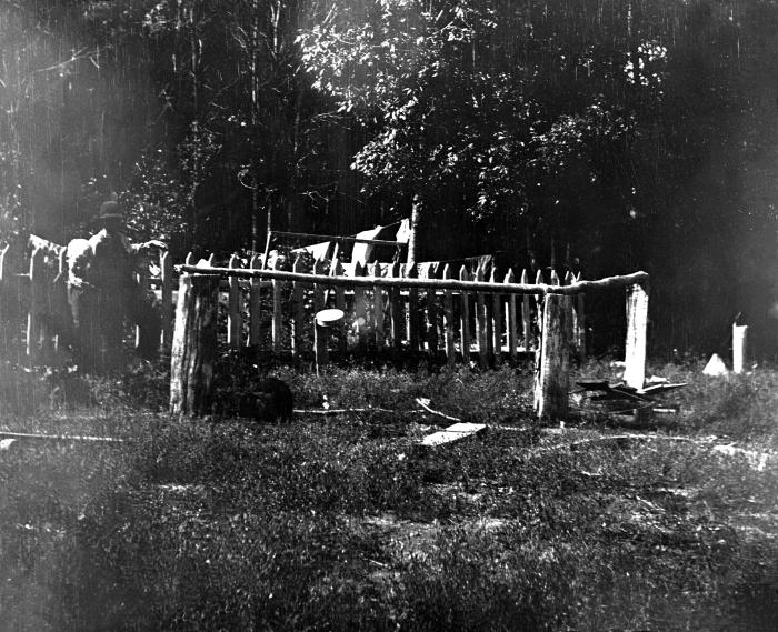 This is a 1909 photograph depicting an improperly constructed 'bored' well on the grounds of a Minnesota farm home. This is one of a series