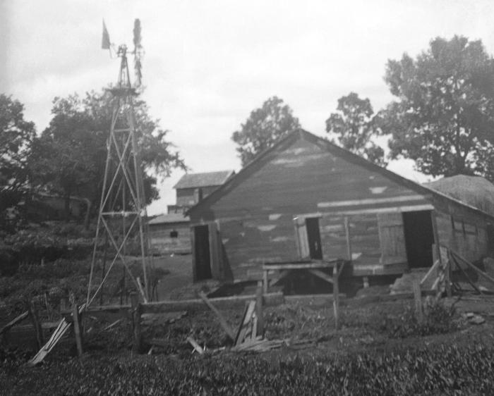 Depicted in this historic image, was an improperly constructed 'driven' well on the grounds of an early twentieth-century farm home located