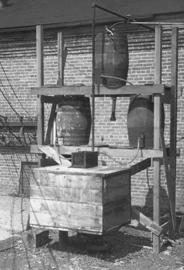 This historic photograph depicted a portable emergency hypochlorite device that in this case, had been used to stop a 1914 epidemic of typho