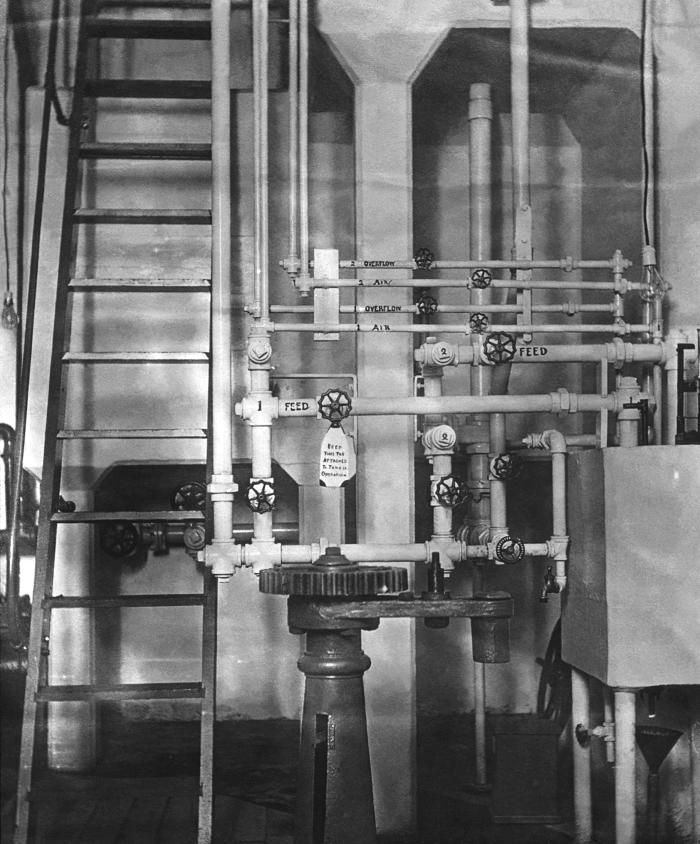This historic 1913 photograph depicted the interior of a hypochlorite plant located in Duluth, Minnesota. The image revealed some of the det