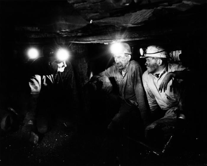 Wearing head-lamps to light their way through this coal mine, this historic image, provided by the Center for Disease Control's (CDC), Natio