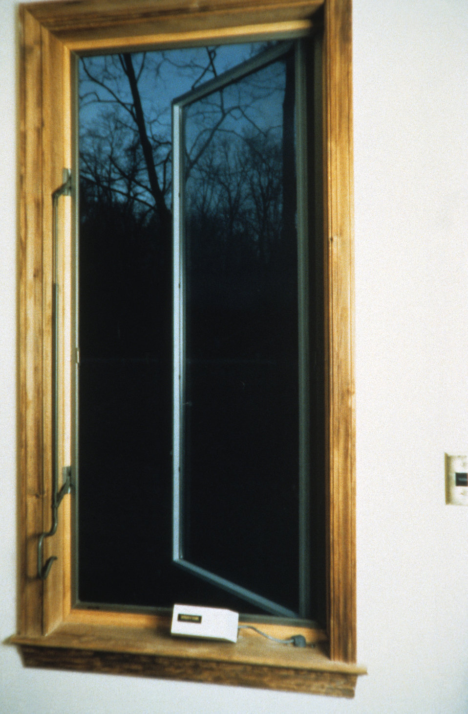 This 1995 image depicted an electronically controlled casement window mechanism. The window, opened here in this photograph, was opened and