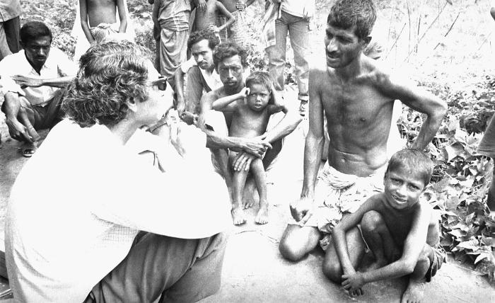 This 1975 image depicted World Health Organization (WHO) epidemiologist Dr. Hari Mehta, discussing smallpox issues with local Bangladesh vil