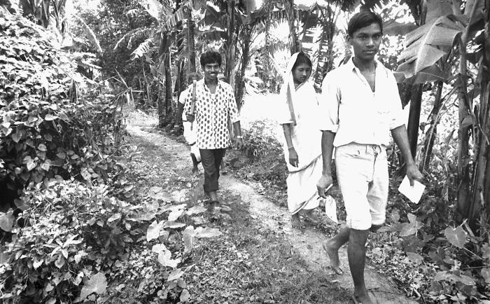 These Bangladesh residents, who were also local eradication team volunteers, were walking along a trail, going from house to house in search