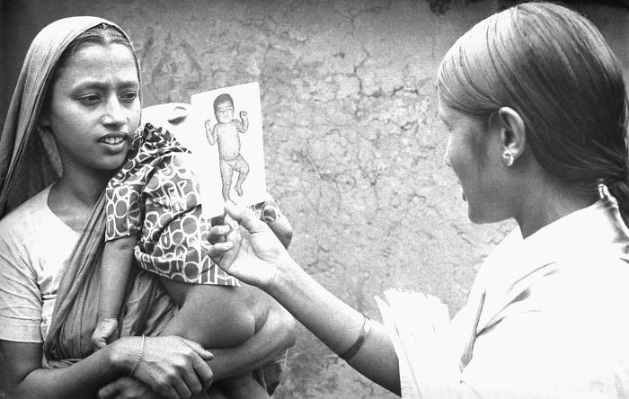 After she'd checked the smallpox vaccination scar on this mother and child's forearms, the volunteer smallpox eradication team vaccinator wa