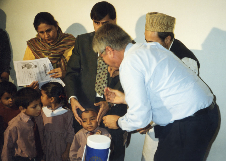 Here Bob Baldwin, Assoc. Dir., Off. of Global Health administers a polio immunization to a Pakistani child in rural Pakistan.