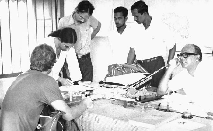 One of the District Teams was shown here in this 1975 image as they were discussing how to most efficiently deploy the smallpox eradication