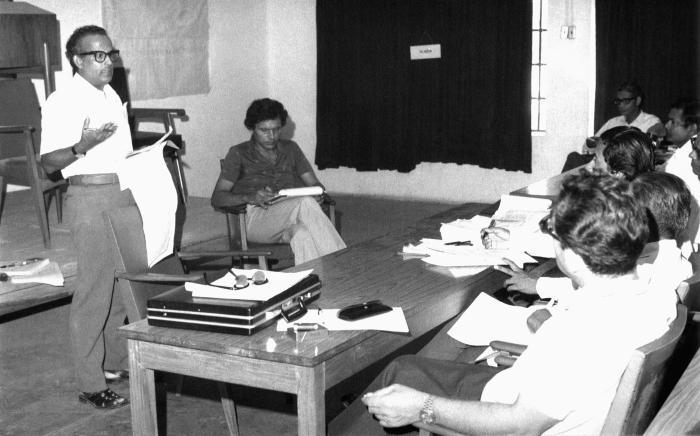 The Bangladesh Malaria Program Director, Dr. Mujibur Rahman (standing), along with Dr. Daniel Tarantola (seated, facing camera), two of the