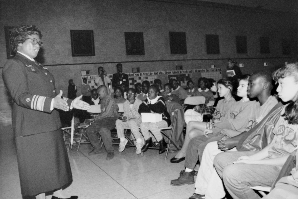With reporters and television cameras on hand, this 1993 photograph showed the Surgeon General, Dr. Joycelyn Elders (1993 - 1994) as she was