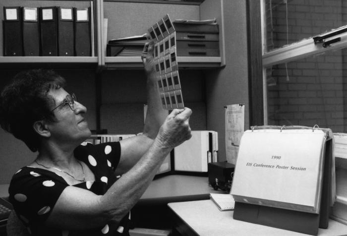 This 1992 photograph showed Centers for Disease Control employee Ruth Kurtz, as she was reviewing 35mm slides that had been taken at a 1990