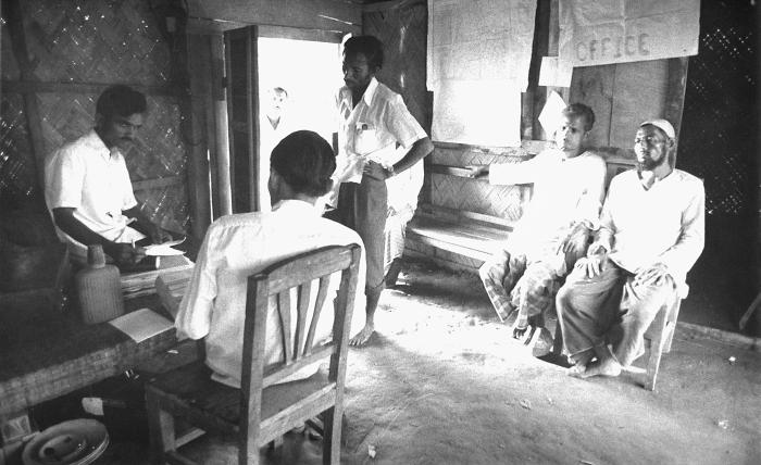 As members of the smallpox eradication team, these Bangladesh men were photographed while they discussed the progress being made regarding e