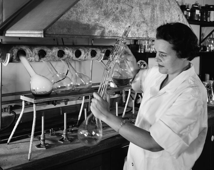 This historic image depicted laboratorian, Ms. Janet Spillane, as she was carrying out a determination of the total nitrogen contained in a