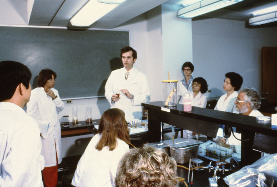 This 1981 photograph depicts a lab instructor and students during a CDC lab training course.